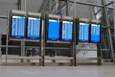 Departure and arrival boards at the airport