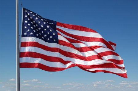 Photo for American flag flying with blue sky - Royalty Free Image