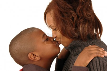 African american mother and son kissing