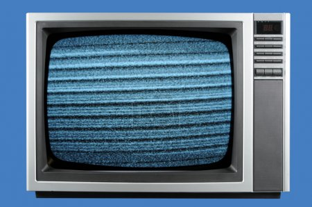 Photo for Vintage television isolated on a blue background - Royalty Free Image