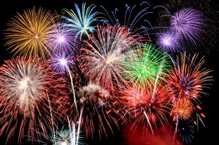 Photo for Fireworks of various colors busting against a black sky - Royalty Free Image