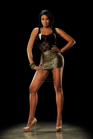 Photo for Young Black Woman wearing a mini skirt n a dark background - Royalty Free Image