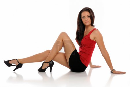 Young brunette woman wearing a short skirt