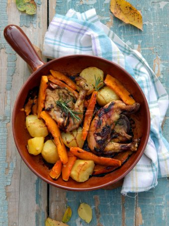 Chicken, baked with pumpkin, potates