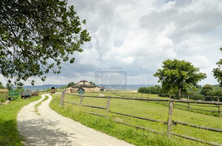 Photo for Countryside landscape with clouds in the background and old wooden farm - Royalty Free Image
