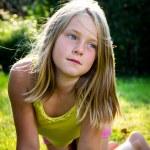 Portrait of a little girl in a meadow...