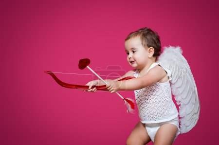 Photo for Baby cupid with a bow, arrow and wings - Royalty Free Image