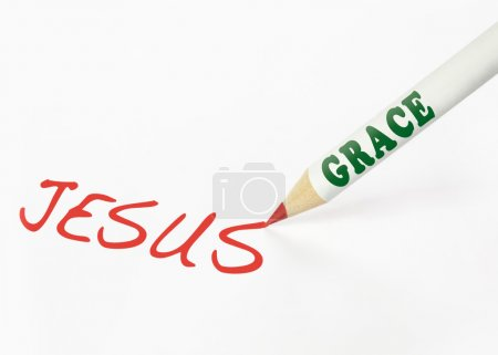 Photo for A Grace labeled pencil writing the word Jesus - Royalty Free Image