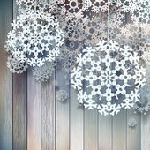Christmas decorations snowflakes hanging over wooden background EPS 10 vector