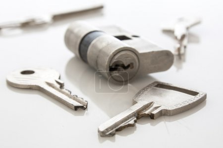 Photo for Door lock with keys on white - Royalty Free Image