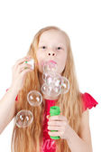 Picture of funny little girl blowing soap bubbles