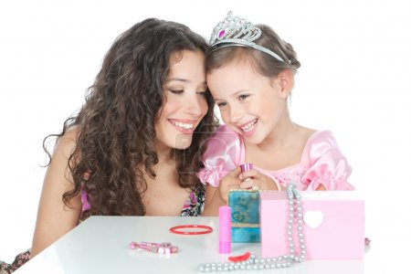 picture of happy mother and little girl dressed as princess