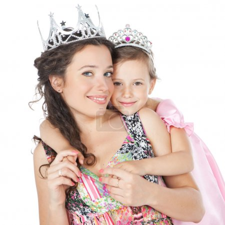 Photo for Little princess in pink dress and her mother hugging each other over white - Royalty Free Image