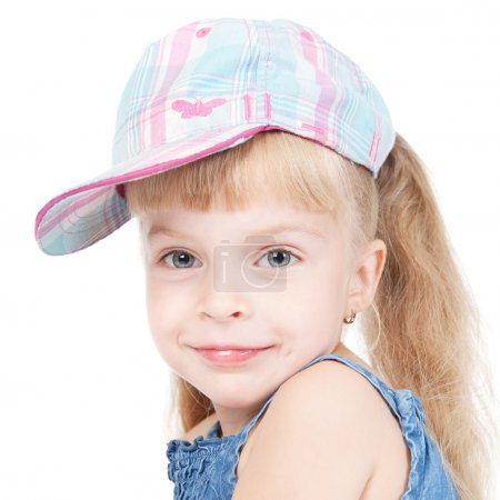 Photo for Beautiful little blonde girl in a cap over white - Royalty Free Image