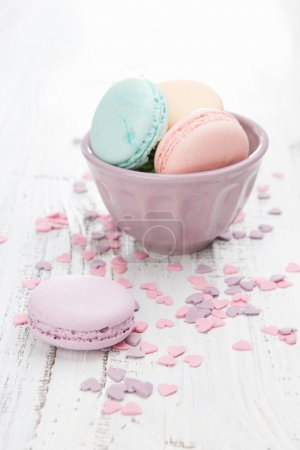 Photo for Colorful macaroons on a white wooden table - Royalty Free Image