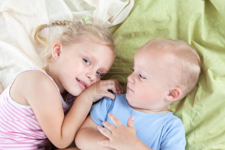 Funny girl with little brother