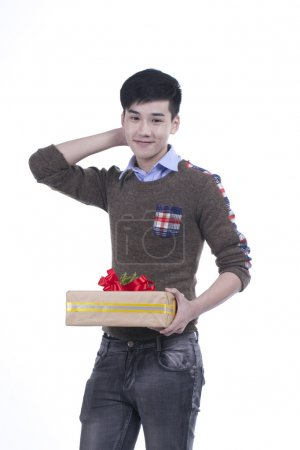 Young Asian handsome guy holding big box of gift