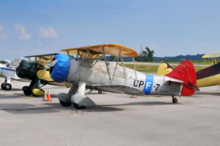 Vintage aircarft on the ground including PT-17 and...