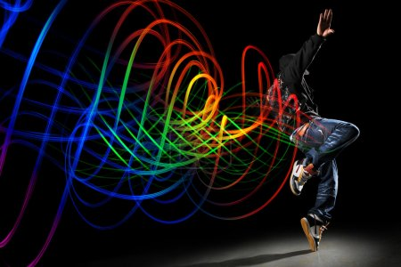 Dancer with Waves of Light Over Black Background