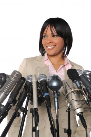 Woman In front of Microphones