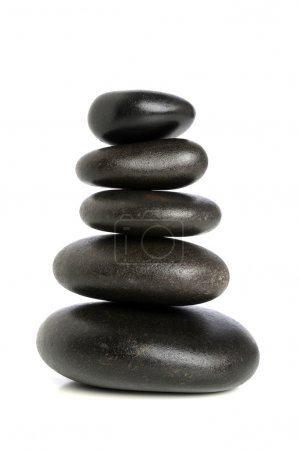Photo for Fives black stones stacked upon each other isolated over white background - Royalty Free Image