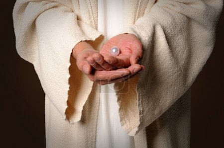 The Hands of Jesus Holding Pearl