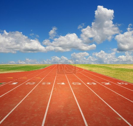Photo for Running track with eight lanes with sky and clouds - Royalty Free Image