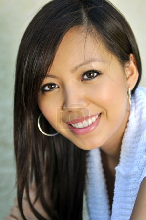 Portrait of beautiful young Asian woman smiling...