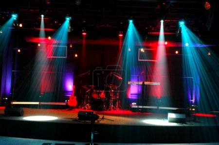 Photo for Stage with red and blue lights and musical instruments - Royalty Free Image
