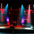 Stage with red and blue lights and musical instrum...
