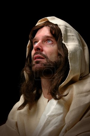 Photo pour Jésus pleura. Représenté par le portrait de Jésus regardant au ciel et versant une larme . - image libre de droit