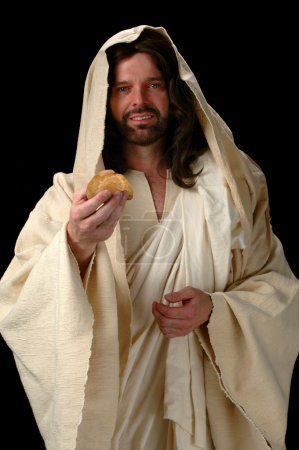 Photo for Jesus, the Bread of Life represented by Jesus offering bread. - Royalty Free Image