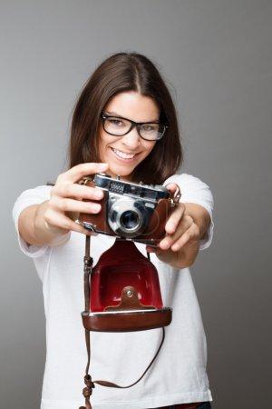 Retro photographer girl holding camera