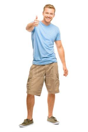 Foto de Hombre feliz dando pulgares arriba muestra - retrato de cuerpo entero sobre fondo blanco - Imagen libre de derechos