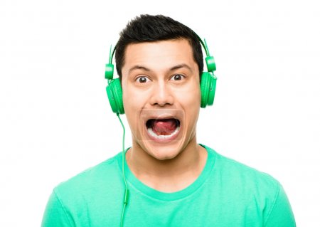 Photo for High resolution portrait crazy asian man pulling funny faces wearing headphones isolated on clean white background - Royalty Free Image
