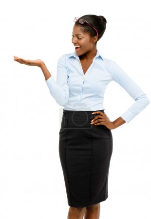 Happy African American businesswoman showing empty copy space
