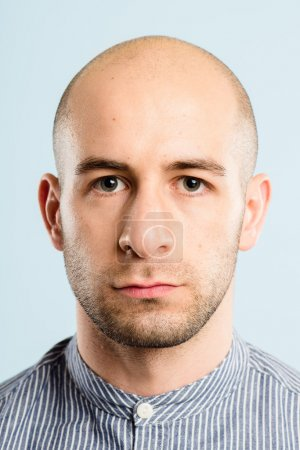 serious man portrait real high definition blue background