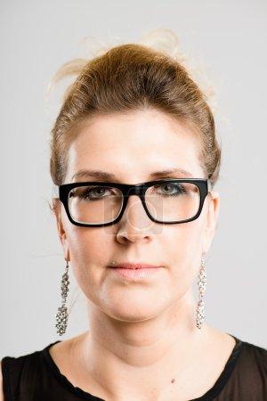 serious woman portrait real high definition grey backgrou