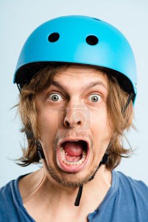 Funny man wearing cycling helmet portrait real hig...