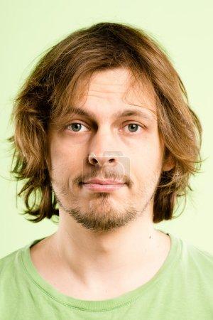 Serious man portrait real high definition green backgroun