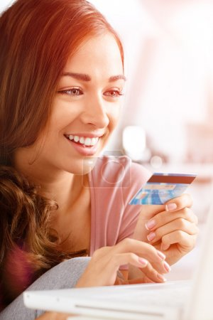 happy teenager woman using credit card shopping online laptop co
