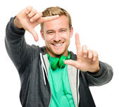 Sexy young man wearing headphones framing photograph isolated on