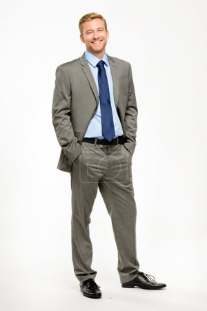 Happy businessman standing isolated on white