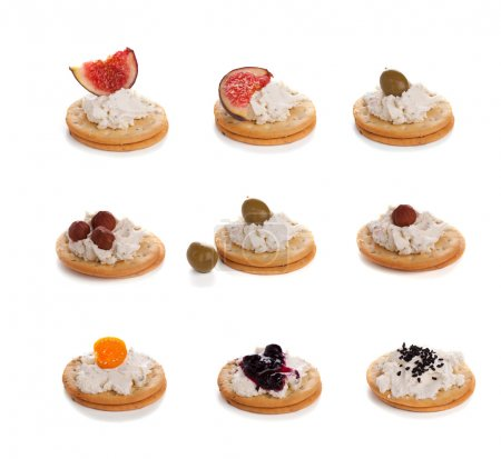 Variety of cracker canapes with cream cheese...