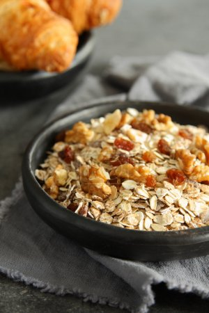 Photo for Healthy homemade granola cereal with nuts and raisins on gray background - Royalty Free Image