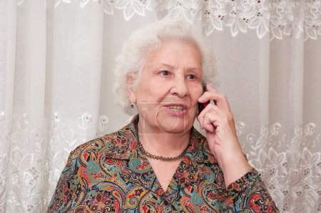 Senior woman speaks on the mobile phone