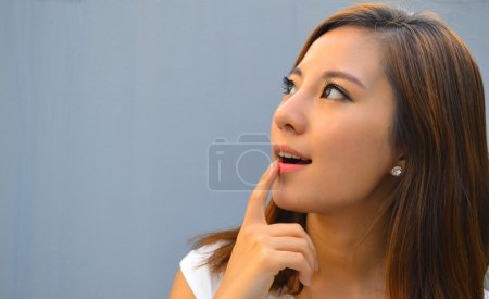 Beautiful young asian woman thinking