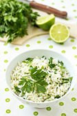 White rice with lime and parsley in a bowl
