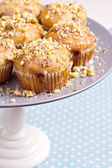 Banana muffins with walnuts and white chocolate on a cake stand