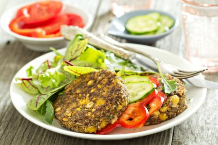 Photo for Vegan chickpeas burgers with salad and vegetables - Royalty Free Image